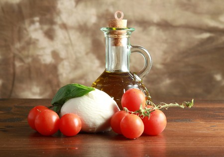 mozzarella with tomatoes, oil and basil photo