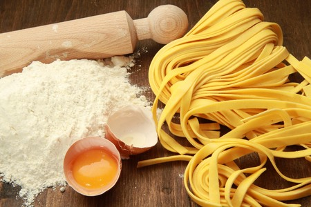 Fresh pasta with egg and flour photo