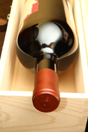 Red wine bottle in box Stock Photo - 8261515
