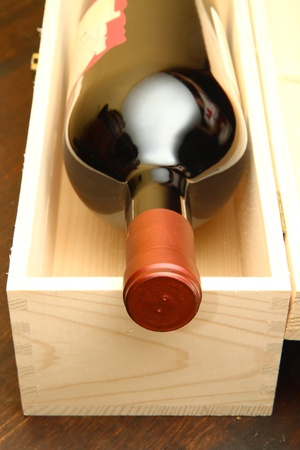 Red wine bottle in box  photo