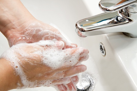 bathe: washing hands  Stock Photo