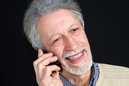 mature man talking on his mobile phone  Stock Photo - 8726259