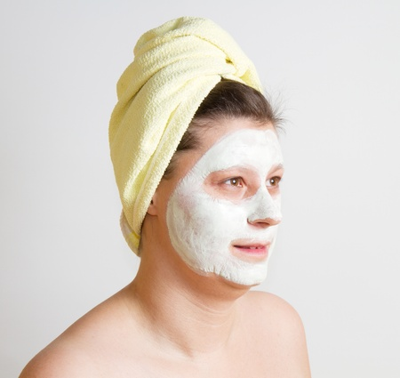 Portrait of a beautiful young girl wearing facial mud mask Stock Photo - 8859539