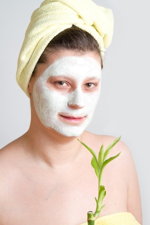 Portrait of a beautiful young girl wearing facial mud mask Stock Photo - 8859471