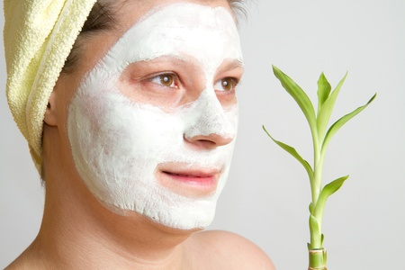 Portrait of a beautiful young girl wearing facial mud mask Stock Photo - 8859495