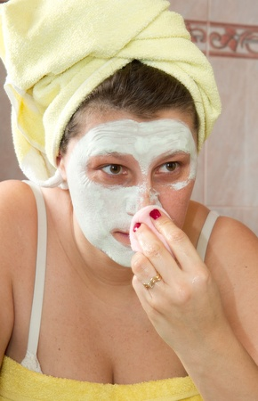 Portrait of a beautiful young girl wearing facial mud mask Stock Photo - 8859543