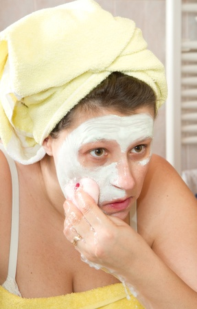 Portrait of a beautiful young girl wearing facial mud mask Stock Photo - 8859477