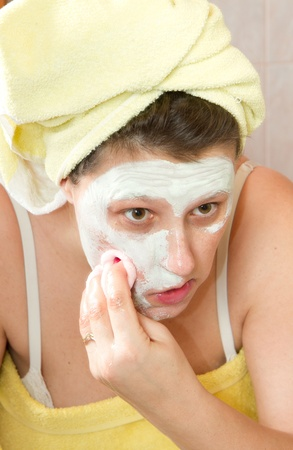 Portrait of a beautiful young girl wearing facial mud mask at the spa Stock Photo - 8859501