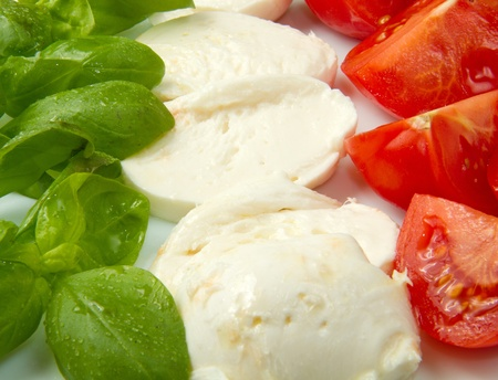 Italian flag made wit Tomato Mozzarella and Basil  photo
