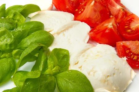 italian cooking: Italian flag made wit Tomato Mozzarella and Basil