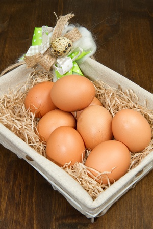 Eggs in a basket  on wodden table photo