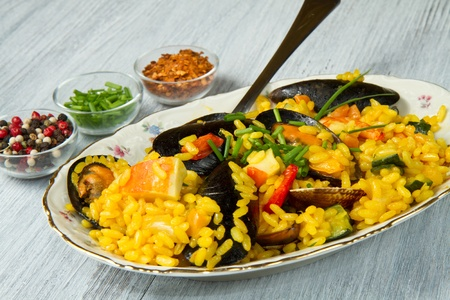 Close-up of Spanish paella on white plate photo