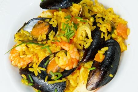 Close-up of Spanish paella on white plate photo