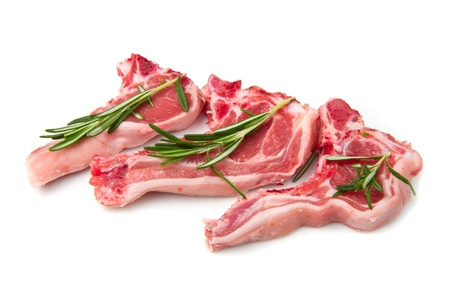 lamb chop: Racks of lamb, ready for cooking, with fresh rosemary