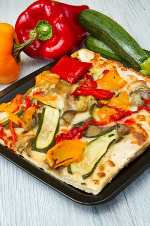 slice of pizza with fresh vegetables Stock Photo - 9347777