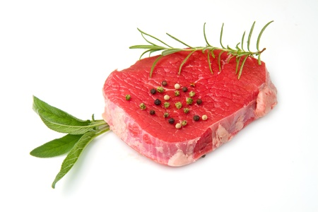 a red meat with sage and rosemary isolated on white background Stock Photo