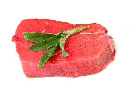 a red meat with sage and rosemary isolated on white background photo