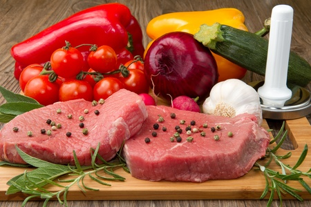 red meat with fresh vegetables photo