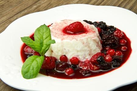 pannacotta: italian panna cotta dessert with fresh berries