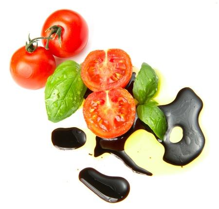 Fresh tomato and basil over olive oil and balsamic vinegar  photo