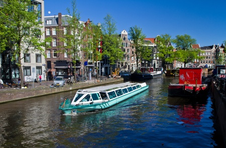 Beautiful houses on a canal in Amsterdam Stock Photo - 9546749