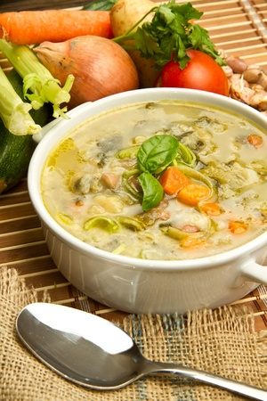 bowl of minestrone with fresh vegetables photo