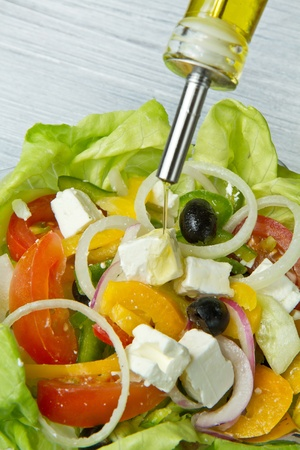 Feta salad with tomatoes, black olives  and fresh vegetables photo