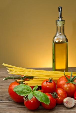 sauce bottle: spaghetti ingredients on wood table Stock Photo
