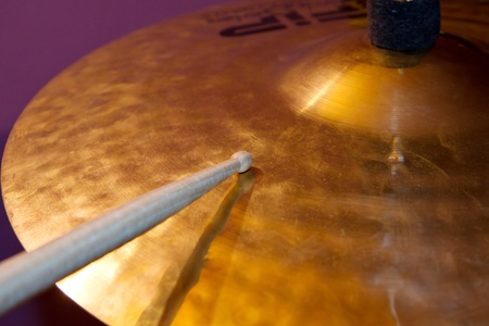 hi hat: Close up of drum kit with cymbal and drumsticks