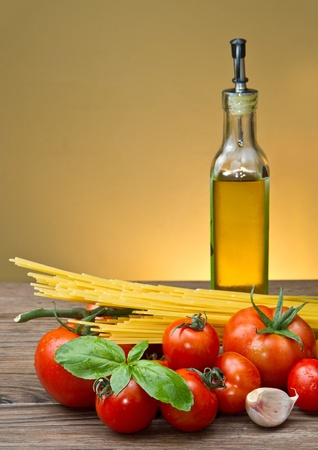 italian cooking: spaghetti ingredients with fresh tomatoes