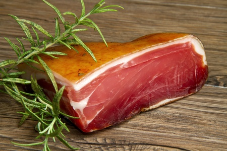 tyrol: a piece of speck on wooden table
