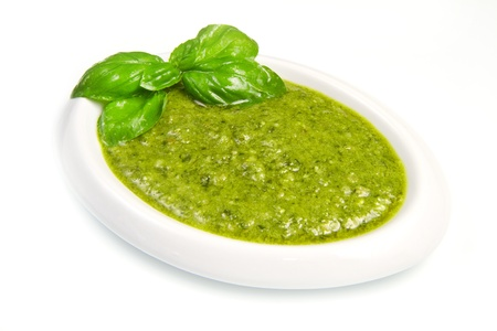 pesto sauce isolated on white background photo