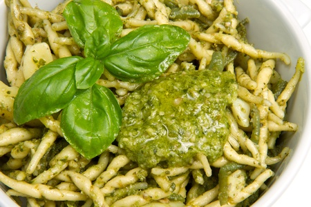 pasta with pesto on white plate photo