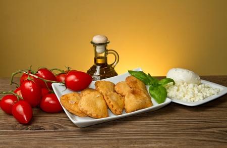 classic italian panzerotti with tomatoes and mozzarella photo