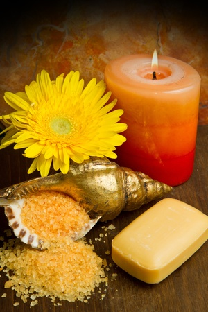 purifying: Soap and  flowers on wooden table Stock Photo