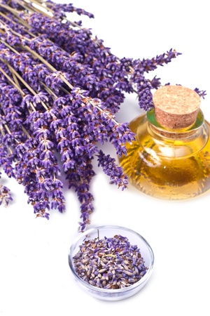aromatherapy oils: lavender flowers with oil  isolated on white background Stock Photo
