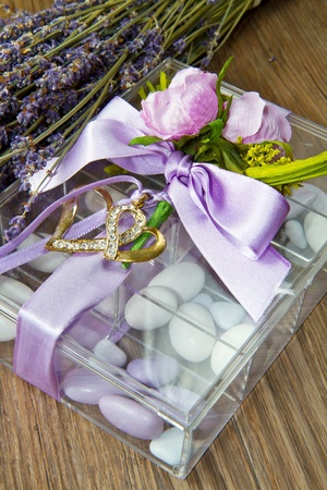 wedding favor with lavender flowers  on wooden table photo