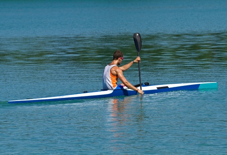 canoe paddle: Young athlete in a canoe