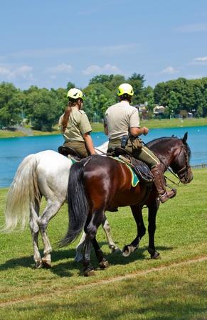 police officer on horseback in the park photo