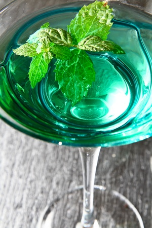 cocktail with fresh leaf of mint photo