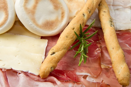 a platter of mixed cured meats, cheeses and fried dumpling photo