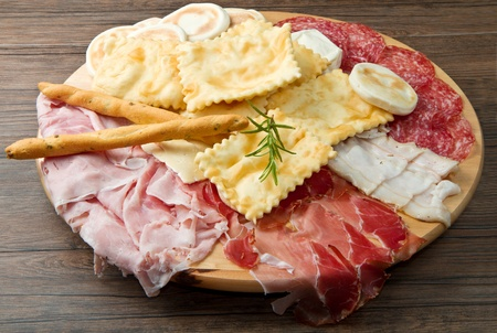 meats: a platter of mixed cured meats, cheeses and fried dumpling