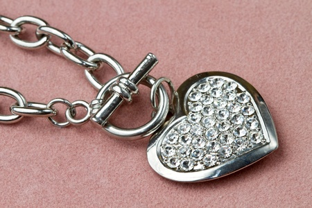 Nice golden bracelet in heart shape  photo