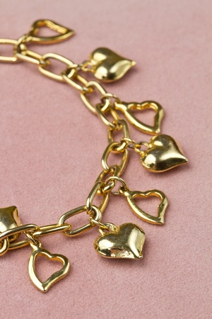 Nice golden bracelet in heart shape  photo