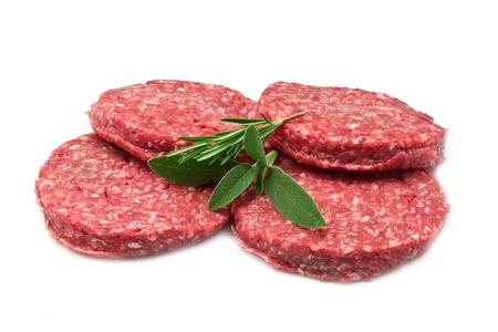 hamburgers: raw hamburger isolated on white background