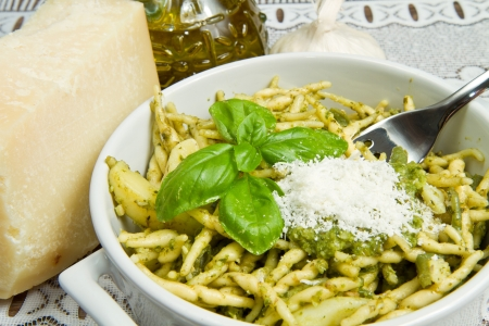 pasta with pesto on white plate photo
