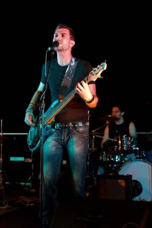 guitarists: Electric bass-guitar player during a concert Stock Photo