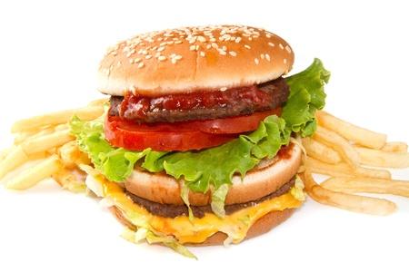 Hamburger mit Kartoffeln auf wei�em Hintergrund Lizenzfreie Bilder