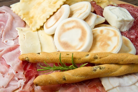 a platter of mixed cured meats, cheeses and fried dumpling Stock Photo - 10386860