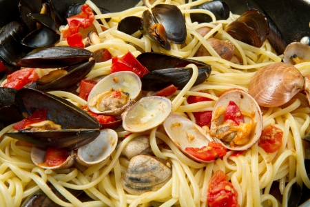 clam: pasta with fresh mollusk and tomatoes sauce Stock Photo